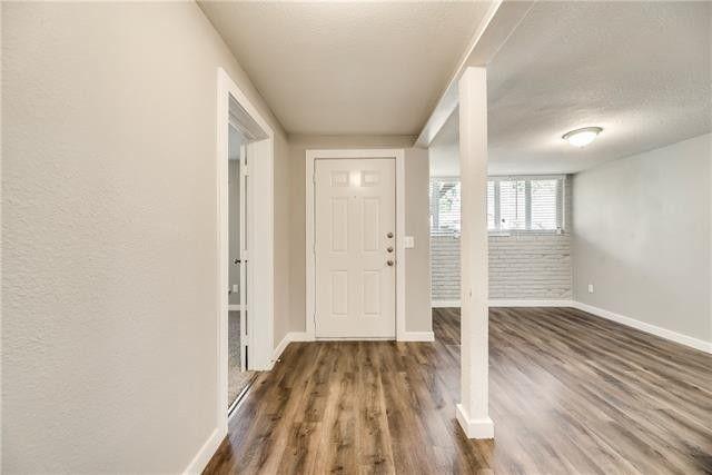 room with a dark wooden floor