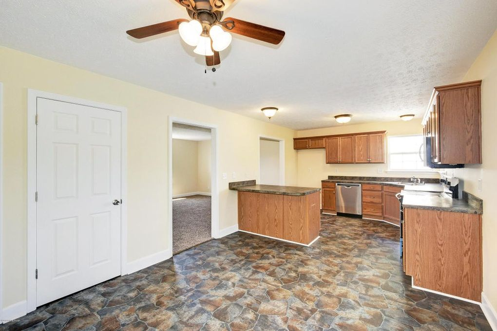 Wooden kitchen renovation with tile floor