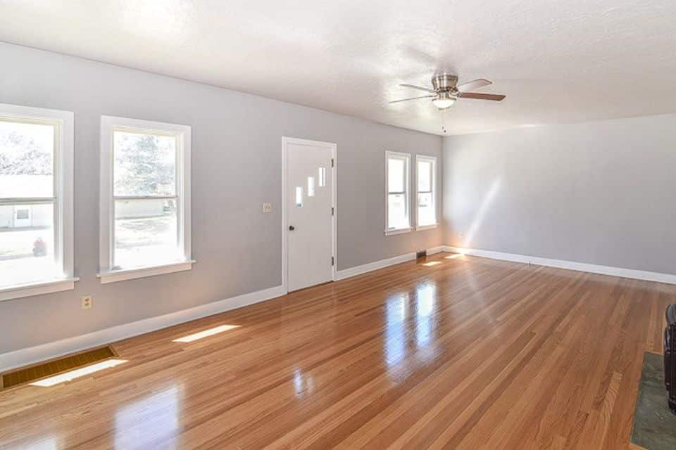 room with windows and white door of a remodeled property