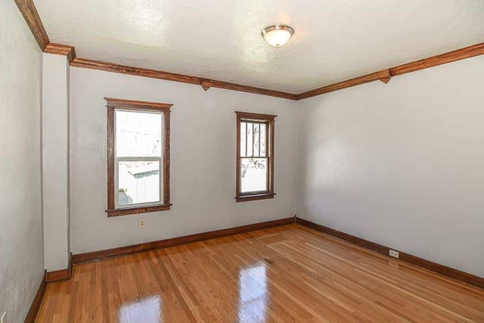 large bedroom with two windows