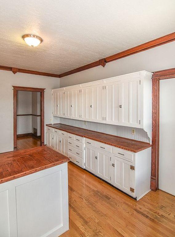White kitchen with wooden floor
